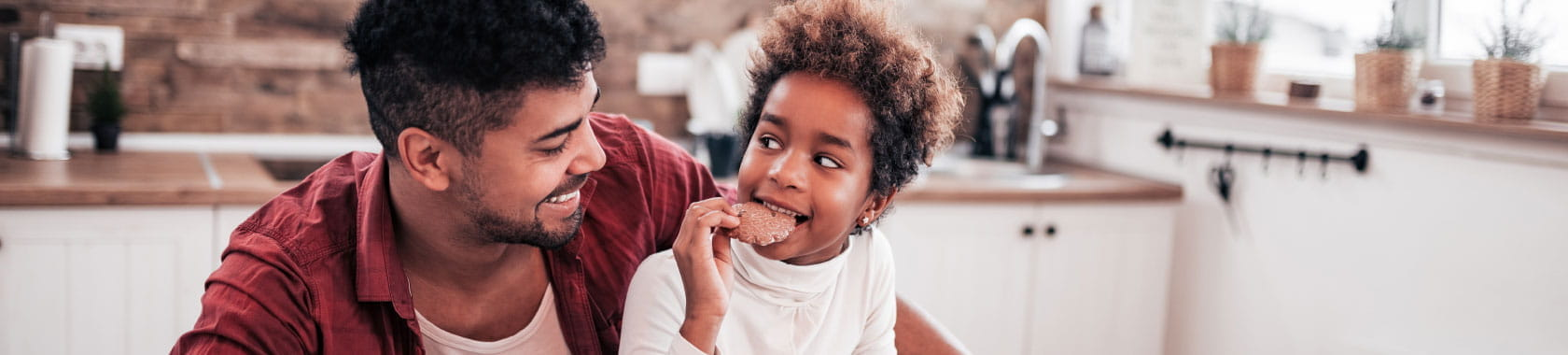 Father and child eating a cookie